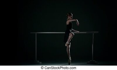ballet dancer wearing an apricot tutu. slow motion - Young...