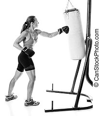 Heavy Bag Exercise - Heavy bag exercise. Studio shot over...