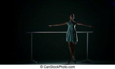 ballerina in a pretty blue dress on a dark background