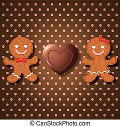 loving couple of gingerbread cookies and heart chocolate on...