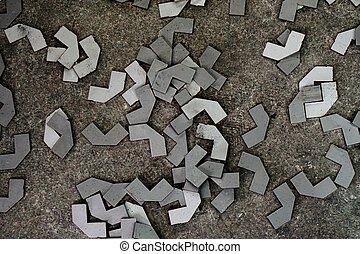 abstract metal spare part on concrete floor