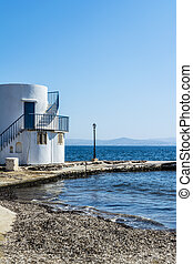 View of traditional fishing village of Empoureio at Milos...