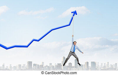 Growing graph - Young businessman hanging on increasing blue...