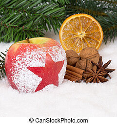 Winter apple fruit on Christmas with snow and star - Winter...