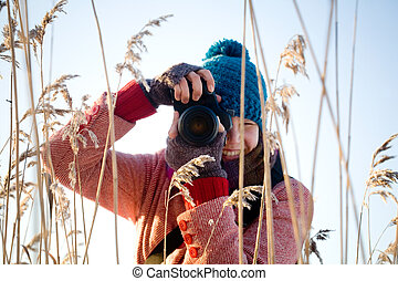 photographer - Young pretty woman taking nature pictures...