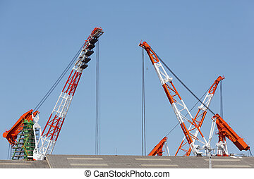 Crane boom against a clear blue sky