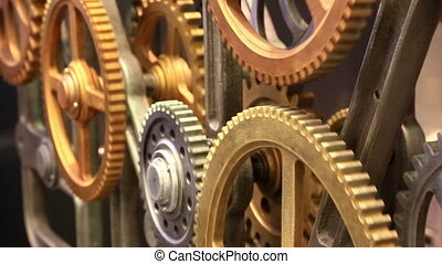 Moving gears of old mechanism close up