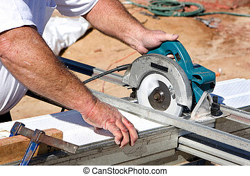 Cutting Soffit With Circular Saw - Construction worker uses...