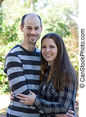 Young Married Couple - Young married couple pose during an...