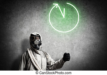 Radioactivity catastrophe - Man in respirator with balloon...