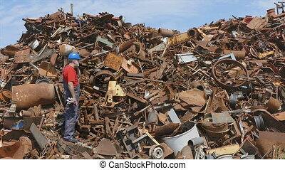 Recycling industry, worker and heap - Metal recycling,...