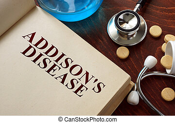 Addisons disease written on book with tablets Medicine...