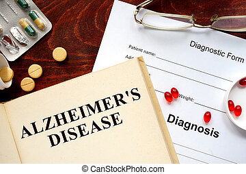 Alzheimers disease written on book with tablets. Medicine...