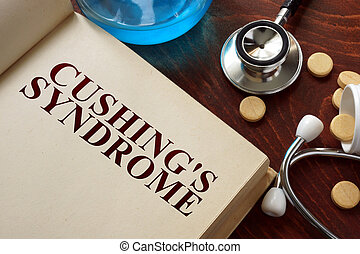Cushings syndrome written on book with tablets. Medicine...