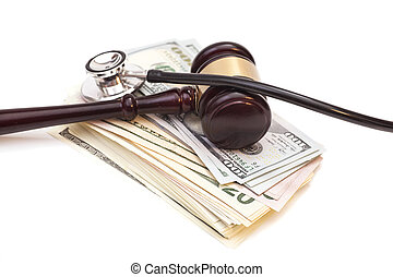 Stethoscope with judge gavel and dollar banknotes isolated on white background