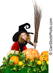 trick or treat - Cute little girl in a witch costume posing...