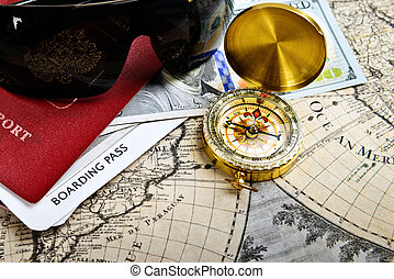 passport, compass, ticket, money, sunglasses on very old word map