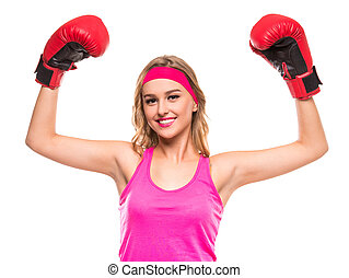 Sporty woman - Young fitness woman is wearing boxing gloves...