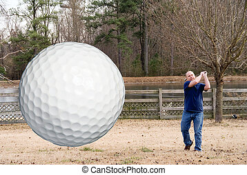 Golf - An airbourne golf ball just after being hit.