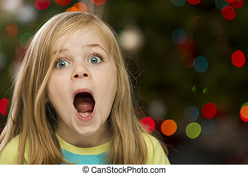 Surprised girl during christmas