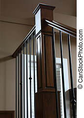 Staircase handrail in wrought iron and oak wood