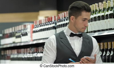 Side view of confident young sommelier - Confident sommelier...