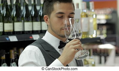 Confident and experienced sommelier. Confident young man...