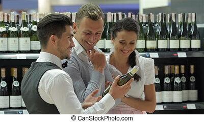 Seller offers bottles of good wine - Seller offers wine...