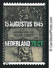 postmark - NETHERLANDS - CIRCA 1985: Dutch women in Japanese...