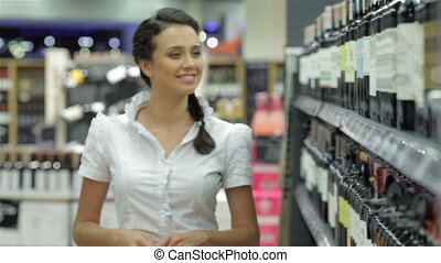 Young woman shopping wine