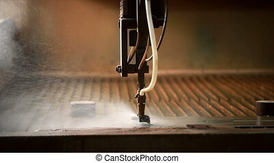Cutting metal by using of water jets and sand View close-up