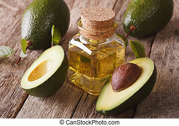 Vitamin avocado oil in a glass bottle on a table close-up,...
