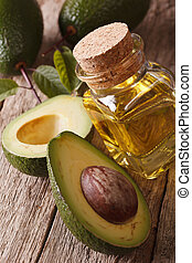 healthy avocado oil in a glass bottle on a table close-up....