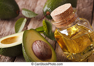 fresh avocado oil in a glass bottle close-up. Horizontal -...