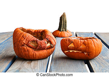 Two aged pumkins on a table