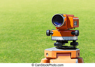 theodolite level tool mounted on tripod - optical level...