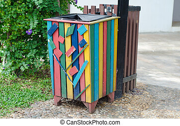 Colorful bin in the park. Trash container