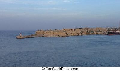 Lighthouse at Fort Ricasoli, Malta - Malta island, Valletta...