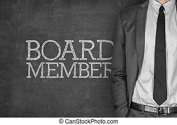Board member on blackboard with businessman in a suit on...