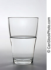 close up shot of an half full water glass - product shot of...