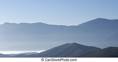 Blue hills - Hills between the mist with clear sky
