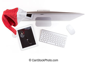 Red santa hat on the Modern Computer Monitor