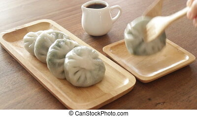 Having steamed dumpling stuff on wooden plate, stock video