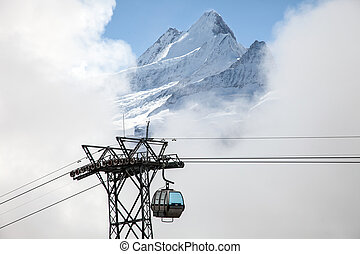 Mountain peaks and cable cars in Grindelwald, Switzerland