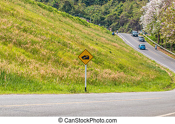 warning steep road sign slope and truck on hill