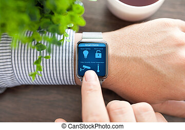 man hands in watch with program smart home on screen - man...