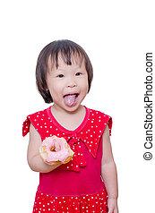 Little girl eating donut - Little Asian girl eating donut...