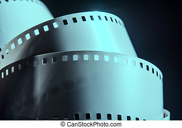 Negative reel of film on a dark background. Photographic...