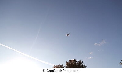 A personal drone flying through the air and landing