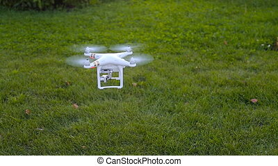 A personal drone landing - A personal drone flying through...